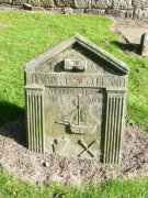Eighteenth century headstone with trade symbols.  Image: Ewan Malecki (October 2007)  Image ID: 1641_29.JPG