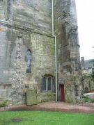 Northwest corner of the tower, with remains of the north choirs window just visible against the circular stair tower at the corner of the square plan tower. The door which has been partially blocked to form a window in the northern elevation is also visible. Image: Amanda Gow (August 2007)  Image ID: 1642_66.JPG