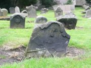 Eighteenth century trade headstones: baker (foreground) and miner (background). Image: Amanda Gow (August 2007)  Image ID: 1642_89.JPG
