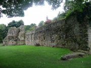 View of the remains of the monks' refectory which consist of the northern wall of the undercroft, taken from the southeast. Image: Amanda Gow (August 2007)  Image ID: 1642_20.JPG