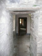 Interior view - ground floor corridor from N