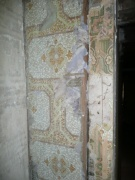 Different wall paper designs and plaster on first floor landing