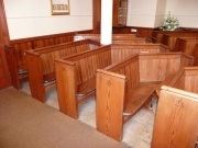 Pine pews in nave, from south