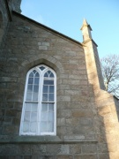 South gable window and corner buttress