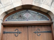 The stained glass fanlight above the doors in the south elevation