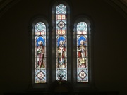 The stained glass window in the chancel