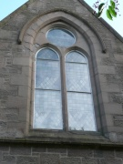 pointed arch window on the east front