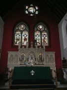 The altar of the chancel with stained glass behind