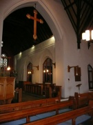 The nave and chancel with chancel arch and wooden rood