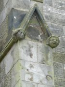Heads on a gable topping a buttress. Image: Kirsty Owen (May 2007).  Image ID: s4692_08.JPG