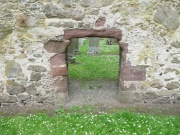 The sunken doorway of the west gable