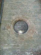 Round window in north wall