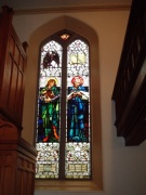 Stained glass window in the west gable