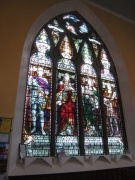 The large South stained glass window