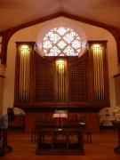 Communion table and organ from north-east