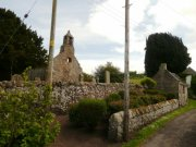 View of St. Magridin's from the road leading past the church. Image: Kirsty Owen (June 2007)  Image ID: s870_01.JPG